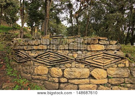 Geometric figures at the pre inca ruin Kuelap high up in the north peruvian mountains, near Chachapoyas. It's a typical pre inca symbol.