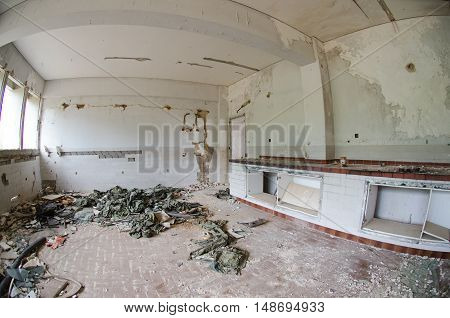 abondoned chemical lamboratory after earthquake army uniform on ground
