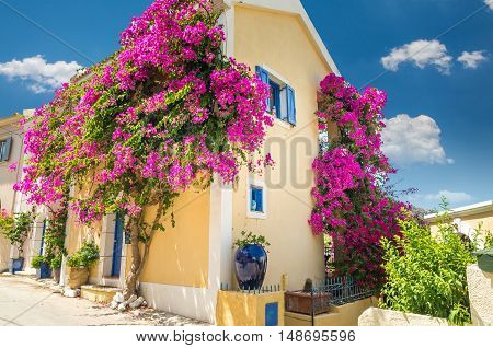 Traditional greek house with flowers in Assos, Kefalonia island, Greece