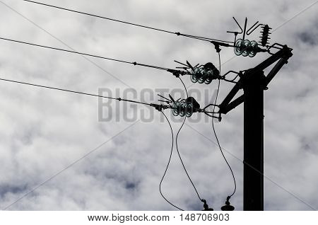 the silhouettte of an electric pole vintage tecnology symbol of communication and energy