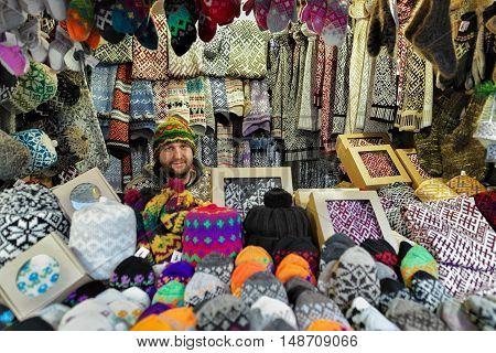 Smiling Man Selling Warm Clothes At The Riga Christmas Market