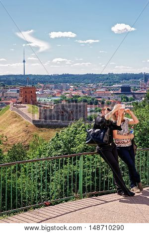 Women Making Selfie With Gediminas Tower And The Lower Castle