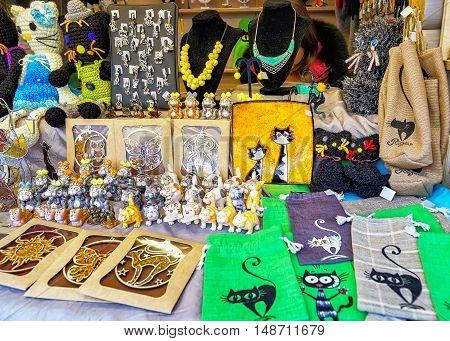 Souvenirs With Cat Symbol Displayed At Riga Christmas Market