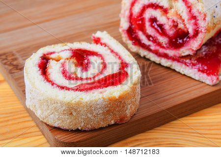 Sweet Roll With Jam On A Cutting Board.