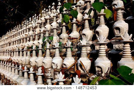 Pengzhou China - November 13 2013: Hundreds of miniature white dagoba burial urns at the Ci Ji Buddhist Temple
