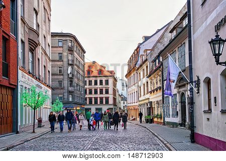 People Walking Around In Old Town Of Riga