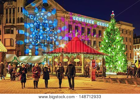 People Walking Around The Christmas Market At Riga Cathedral Square