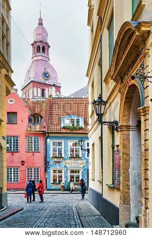 People Walking Around The Old Town Of Riga