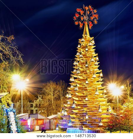 Wooden Christmas Tree And The Market At Night In Riga