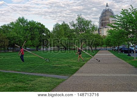 Two Men Carrying Crosses Near The Us Capitol