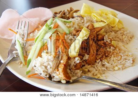 Fried rice with chicken and anchovies traditional malaysian cuisine