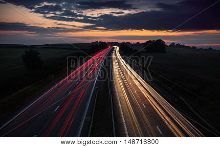 Long Trails of Car Lights at Busy Motorway at Night