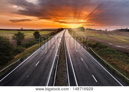 Sunset Sky over Empty Asphalt Road of Dual Carriage Motorway