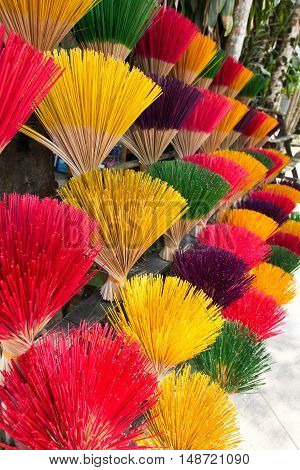 Bunches of colourfull incense sticks for sale in Vietnam. Incense sticks are a important part of the religious offerings in many Aisian nations.