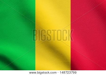 Malian national official flag. African patriotic symbol banner element background. Flag of Mali waving in the wind with detailed fabric texture, illustration