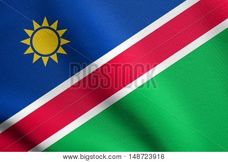 Namibian national official flag. African patriotic symbol banner element background. Flag of Namibia waving in the wind with detailed fabric texture, illustration