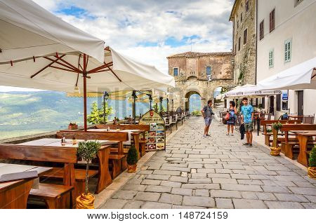Mtovun Croatia- September 2014. View of cafe in old town Motovun Croatia overlooking the valley.