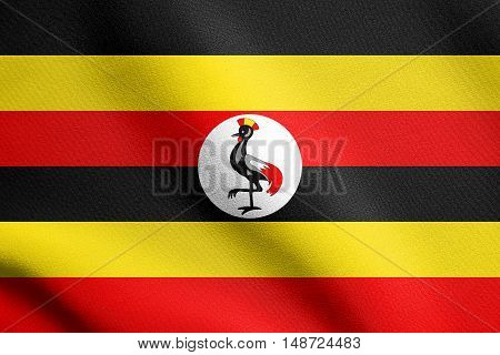 Ugandan national official flag. African patriotic symbol banner element background. Flag of Uganda waving in the wind with detailed fabric texture, illustration