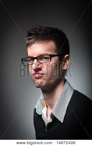 Young University Student With Strange Look On His Face