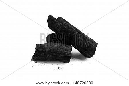 Black charcoal and debris on white background
