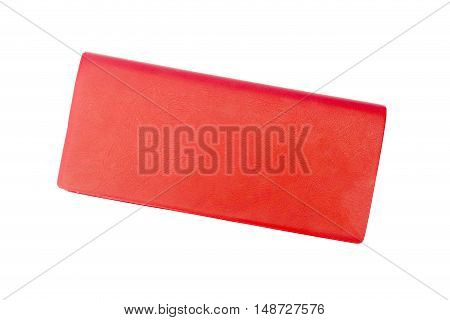Close up red notebook isolated on white background.