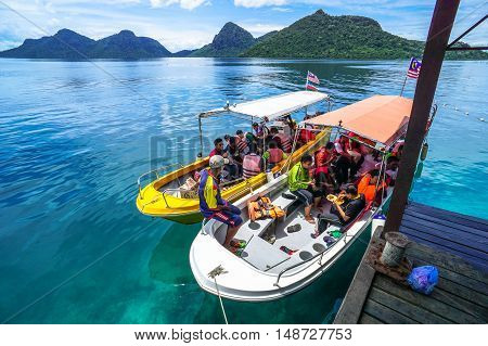 Semporna,Sabah-Sept 10,2016:Speedboat with tourists arrived at Bohey Dulang jetty Semporna,Sabah on 10th Sept 2016.Bohey Dulang Island is one of the most popular islands in Tun Sakaran Marine Park.