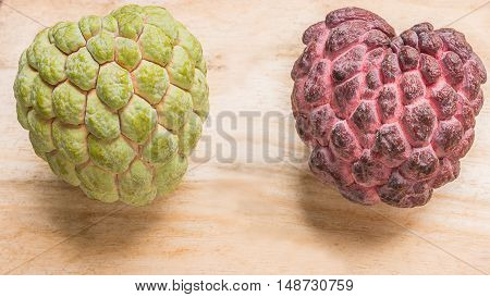 red and green custard apple two species closeup.