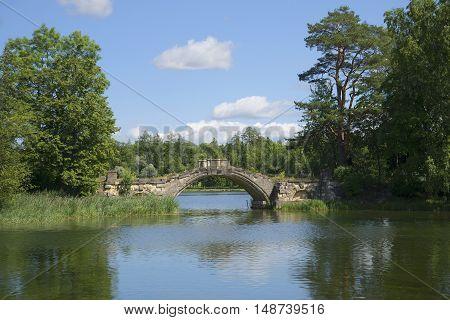 The old Humpback bridge (Bridge between Islands) on White lake. Gatchina, Russia