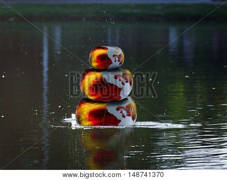 Glowing fire bulky stones in the water. Zen pyramid. Concept - stress yoga meditation Zen