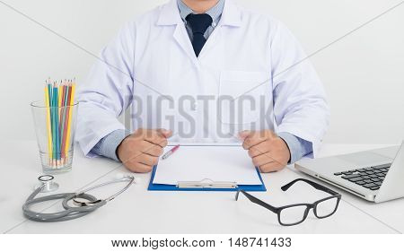 Doctor Sitting At His Desk