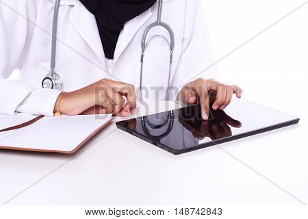 muslimah doctor holding a stethoscope isolated in white background