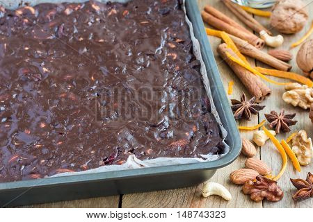 Fresh baked panforte traditional italian christmas dessert with nuts and candied fruits in baking dish horizontal