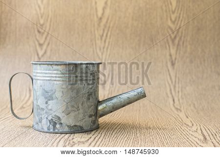 Zinc Watering Can miniature on wooden background