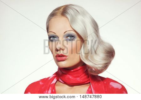 Vintage style portrait of young beautiful girl with platinum blond bleached hair and thin eyebrows