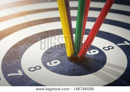 color pencils in bull's eye Success hitting target aim goal achievement concept background
