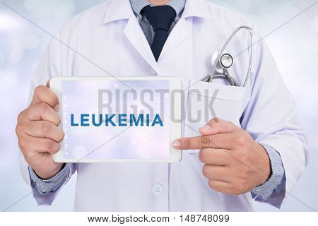 LEUKEMIA CONCEPT Doctor holding digital tablet doctor work hard