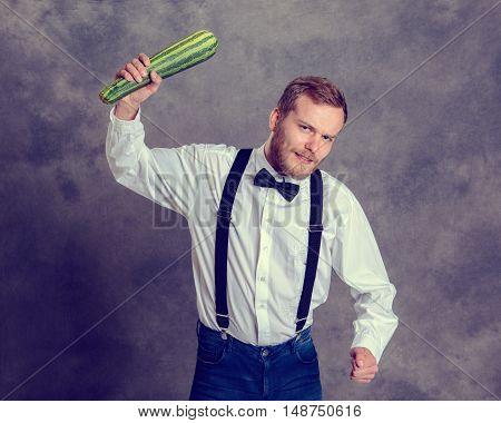Angry Vegetarian Minatory With Zucchini Cudgel