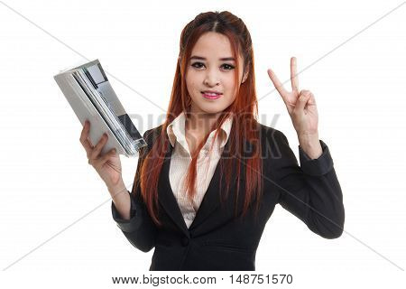 Young Asian Business Woman Show Victor Sign With A Book.