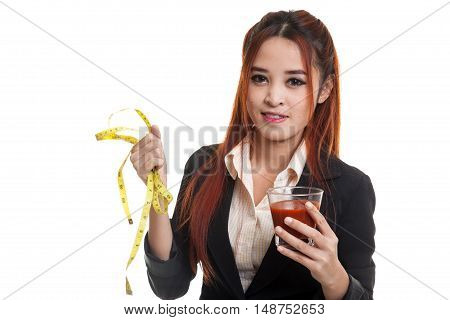 Asian Woman With Tomato Juice And Measuring Tape.