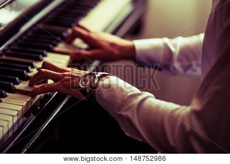 Caucasian Men Practicing Piano Playing. Closeup Photo