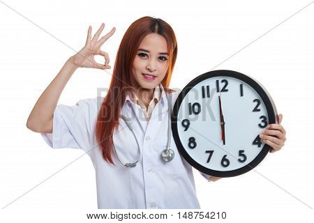 Young Asian Female Doctor Show Ok With A Clock.