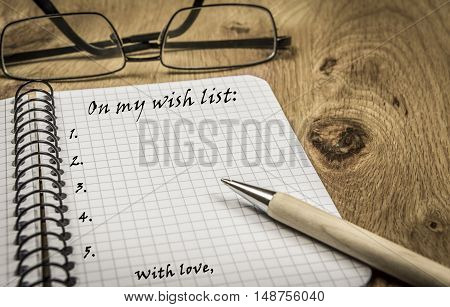 Wish list on spiral notebook - Small agenda notebook with a wish list written on its page in vintage settings