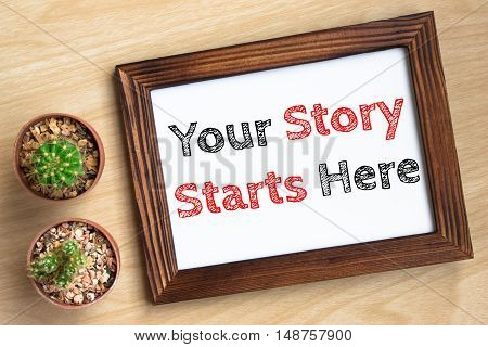 Your story starts here, text message on wood frame board on wood table / business concept / Top view