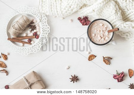 Autumn. Hot chocolate knitted blanket gift dried flowers and autumn leaves. Flat lay top view