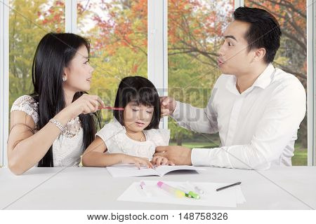 Portrait of two couples having misunderstand and fight while their daughter crying at home