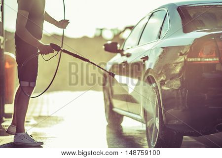 Car Washing and Detailing Photo. Taking Car of a Car.