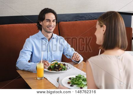 What do you think of this salad. Cute couple spending time in cafe on date and having lunch while eating healthy foods