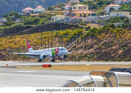 Funchal, Madeira - July 6, 2016: Tap Portugal Airbus A319-111 Lands At Funchal Cristiano Ronaldo Air