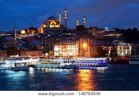 View from Galata Bridge to Suleymanie Mosque in Istanbul, Turkey.