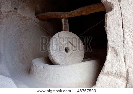 Ancient millstone in Zelve Valley in Cappadocia, Turkey. This process is being made by means of a stone 500 kg weight and 15 m. diameter moving by a rotation mechanism.